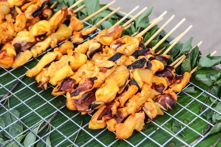 Grilled squid and octopus stick  The local street food in Thailand Stock Photo - 21303668