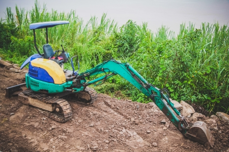Tractor  in the construction site in the local countryside in North East Thailand photo