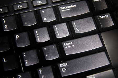 Close up black keyboard  Enter button  photo