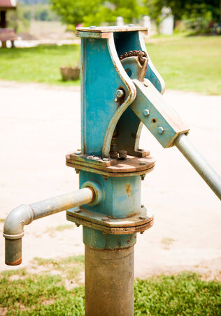 spout:  Traditional Irrigation water Pump in the countryside of Thailand Stock Photo