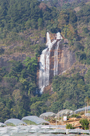 Waterfall among the mountain in Inthanon national park, Chiang Mai, Thailand photo