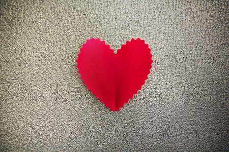 Heart paper on metalic background photo
