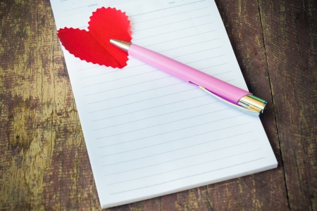 Notebook with heart  Send message to your lover in Valentine Stock Photo - 25288202