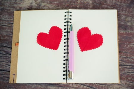 Notebook with heart  Send message to your lover in Valentine Stock Photo - 25592909