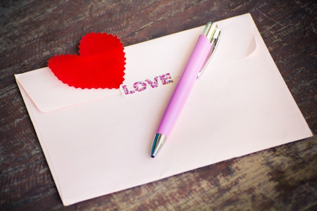 Envelope and pen with heart  Send message to your lover in Valentine Stock Photo - 25579758