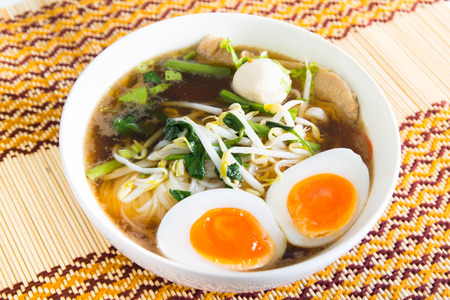 Thai noodle with meatball and boiled egg on table photo