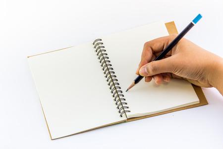 Hand writing on notebook isolation photo