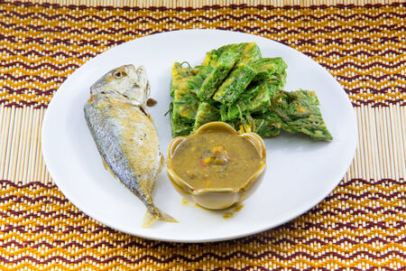Fried Mackerel fish,chili sauce ,and fried vegetable photo