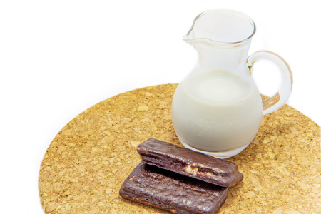 Choccolate bar and a jug of milk photo