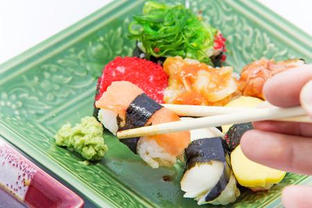 Tasty Japanese sushi on plate photo