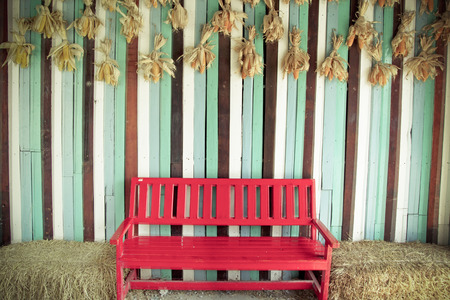 Vintage red chair and wood wall photo