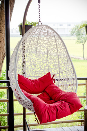 lawn chair: Vintage hanging chair with red seat