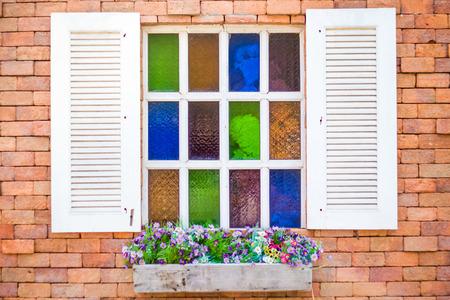 Retro white window on brick wallpaper