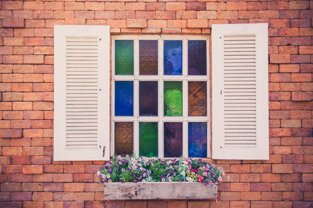 Retro white window on brick wallpaper photo