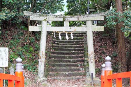Old stone Torii in Japanese shrine