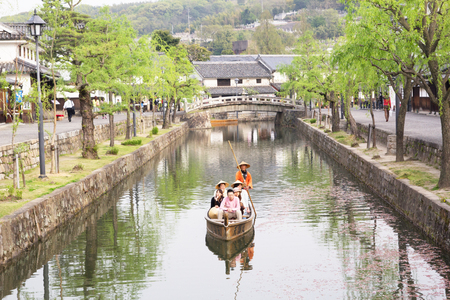 Kurashiki, JAPAN - April 17  Travellers are  floating in gandora boat to view the ancient city of Kurashiki nearby Okayama in, Japan on April 17, 2014