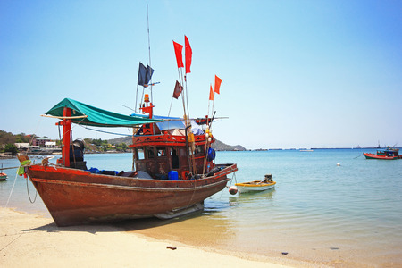 Thai wooden boat for fishing at the beach of Srichang island, Thailand  photo