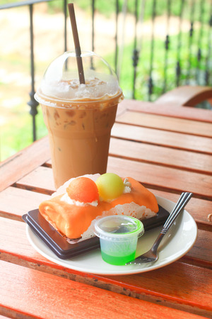Iced coffee and melon crape cake photo