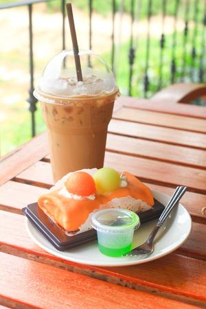 Iced coffee and melon crape cake photo