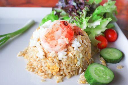 Fried rice with shrimp on dish photo