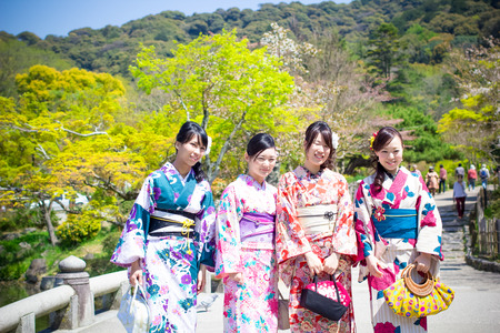 KYOTO, JAPAN - April 15  Japanese gilrs with Japanese traditional suit  Yukata  are walking in the Maruyama park located nearby Yasaka shring in spring season on April 15,2014 at Kyoto, Japan