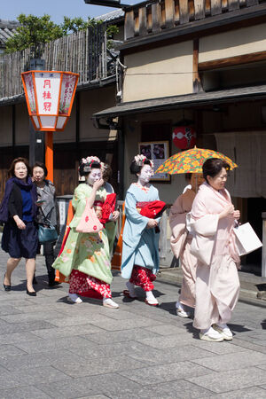 KYOTO, JAPAN - April 15  Traditional geishas are walking pass on Gion street in Kyoto on April 15, 2014 in Kyoto, JAPAN  There are about 2,000 geishas in Japan today, preserving ancient arts and customs in modern life