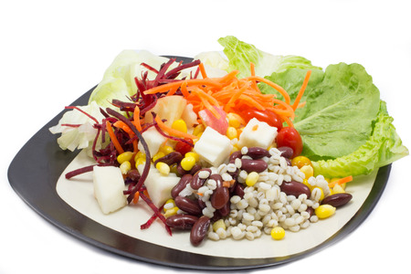 Healthy vegetables salad on dish  photo