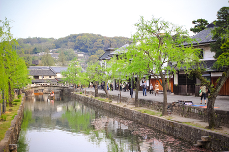 okayama: OKAYAMA, JAPAN - APRIL 17  Kurashiki river in the Kurashiki beautiful historical quarter, Important Preservation Districts for Groups of Historic Buildings, Okayama prefecture on April 17, 2014