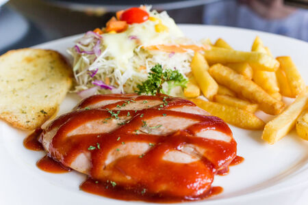 Sausage pork steak with salad and fried potatoes photo