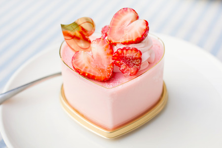 Sweet strawberry cake dessert on a white plate photo