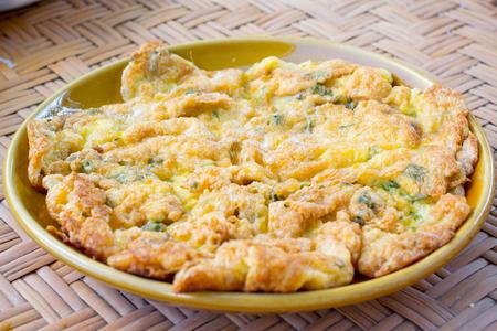 Thai fried egg, omlet on dish photo