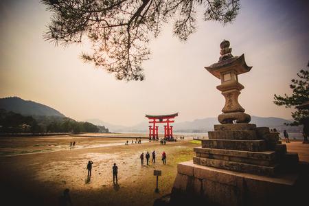 MIYAJIMA, JAPAN - April 16: Giant Torii during low tide near Itsukushima shinto shrine in Miyajima, Hiroshima, Japan on April 16, 2014.