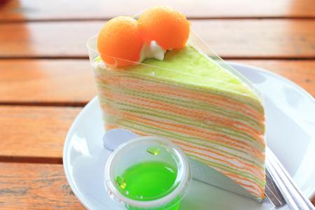 Layer crape cake with fresh melon, a summer dessert photo