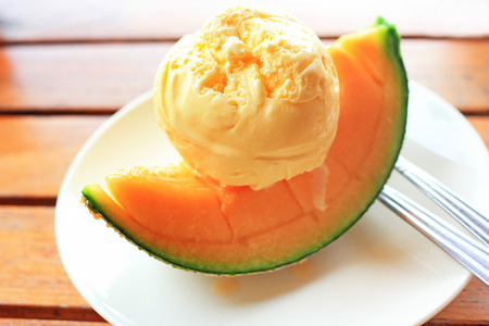 Vanila Icecream with melon piece, a summer dessert Stock Photo