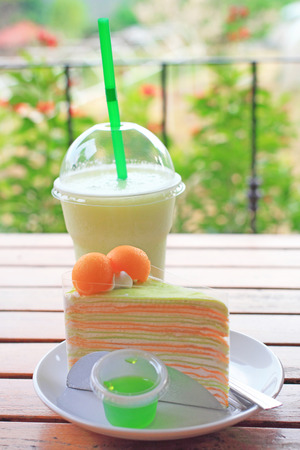 Melon crape cake and melon juice, summer dessert photo