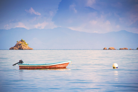 Wooden boat floating in the sea in the southern of Thailand photo