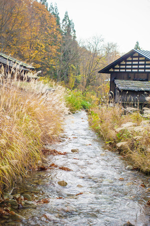 ryokan: Natural view of a little canal and wooden house in Tohoku region,Japan