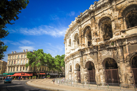 perfectly: NIMES,FRANCE-July 03: Roman amphitheater in Nimes, Provence. Magnificent huge arena perfectly preserved for two thousand years on 03 July 2015.