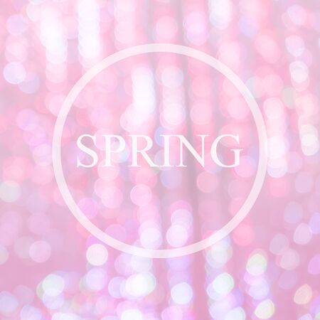 light pink: Pink spring background with defocused lights and spring wording Stock Photo