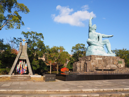 eradicate: NAGASAKI, JAPAN - December 8, 2015: Peace Statue at Nagasaki Peace Park, Nagasaki, Japan