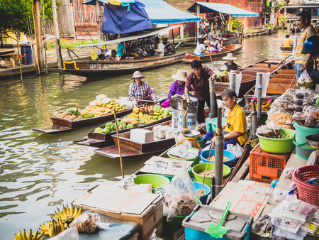 fruit market: RATCHABURI ,THAILAND-MARCH 2016:Damnoen Saduak Floating Market in Ratchaburi Thailand. Several Thai fruit, food, souvenirs are sold in this place. Editorial