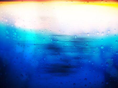 kropla deszczu: Abstract raindrop background on glass window Zdjęcie Seryjne