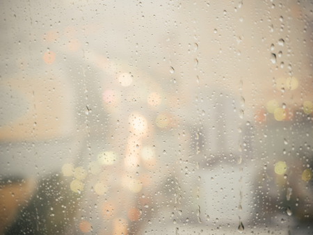 rain wet: Rain drop on glass window with nigh cityscape background Stock Photo