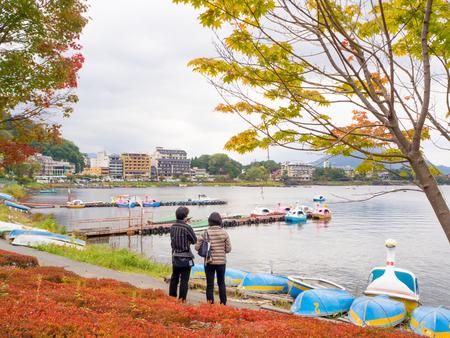 KAWAGUCHIKO, JAPAN - October 23 , 2016 : People standing beside Kawaguchiko lake to relax in late october the begining of autumn in Japan