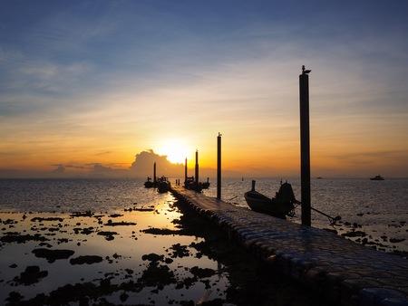 Beautiful landscape of sunrise at pier of Lanta island, Krabi province, Thailand
