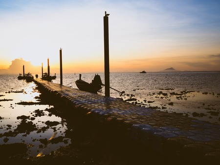 Beautiful landscape of sunrise at pier of Lanta island, Krabi province, Thailand