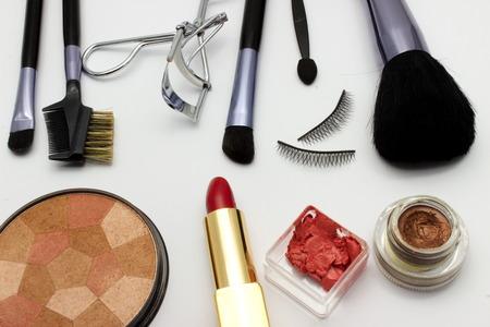 fake eyelashes: makeup products on white background