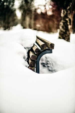 vignetting: bench covered with snow, Bokeh. Vignetting. shallow depth of field Stock Photo