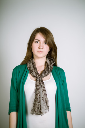 green smiley face: Portrait of a real young woman on a light in a green cardigan. Focus on the eyelashes Stock Photo