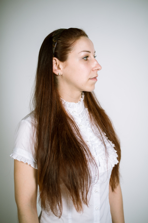 jabot: Portrait of a real young woman in a white shirt with jabot. Focus on the eyelashes